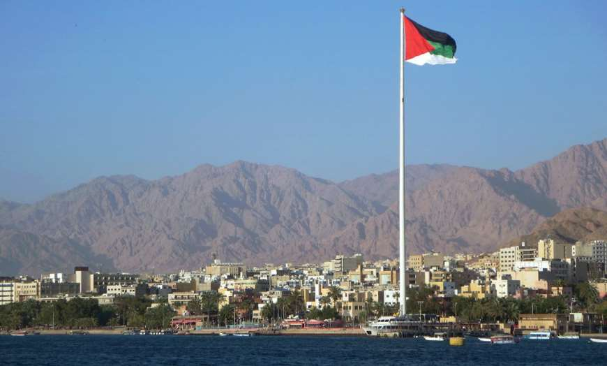 Giant Jordanian flag overlooking the Red Sea coast with the town of Aqaba in the background