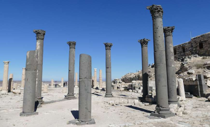 Roman columns at the archaeological site of Umm Qais in Jordan