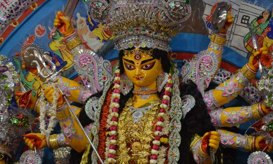 Multi-coloured and bejewelled religious idol during Durga Puja in India