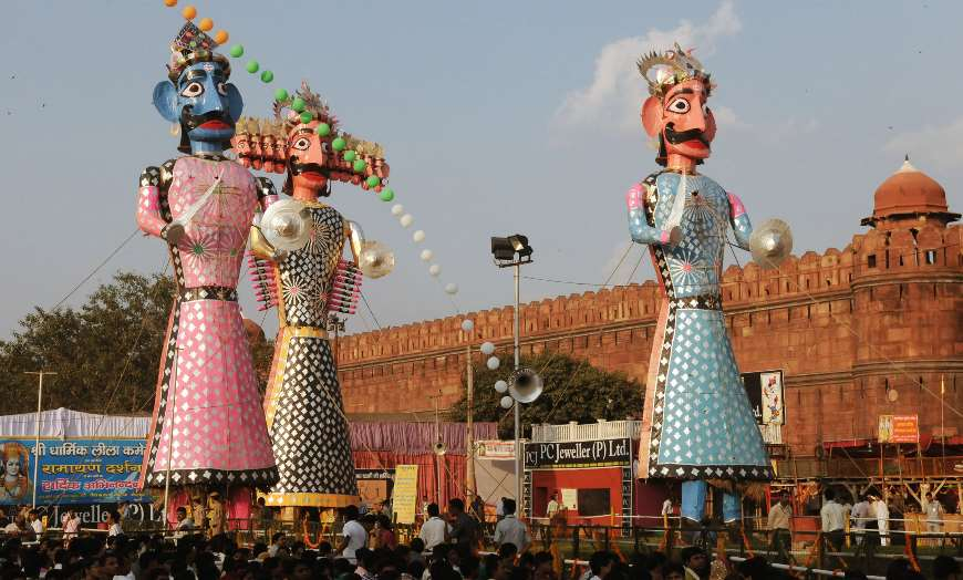 Large effigies paraded through the streets during the Dussehra religious celebrations in India