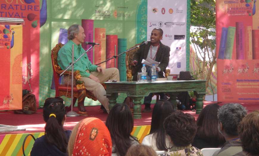 Person interviewing someone on stage at the Jaipur Literature Festival in front of a crowd of people