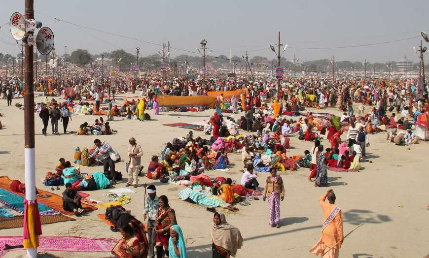 Crowds of sadhus, holy men and pilgrims attending the Kumbh Mela in India