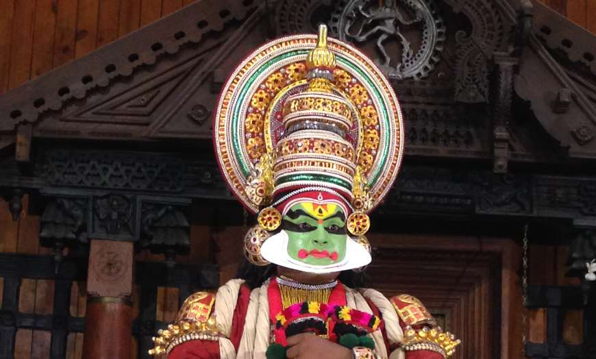 Dancer in traditional masked Kathakali outfit during the Onam festivities in Kerala, India