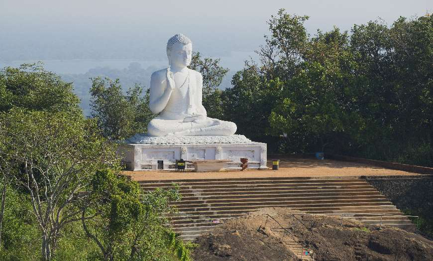 Seated White Buddha in Mihintale Sri Lanka
