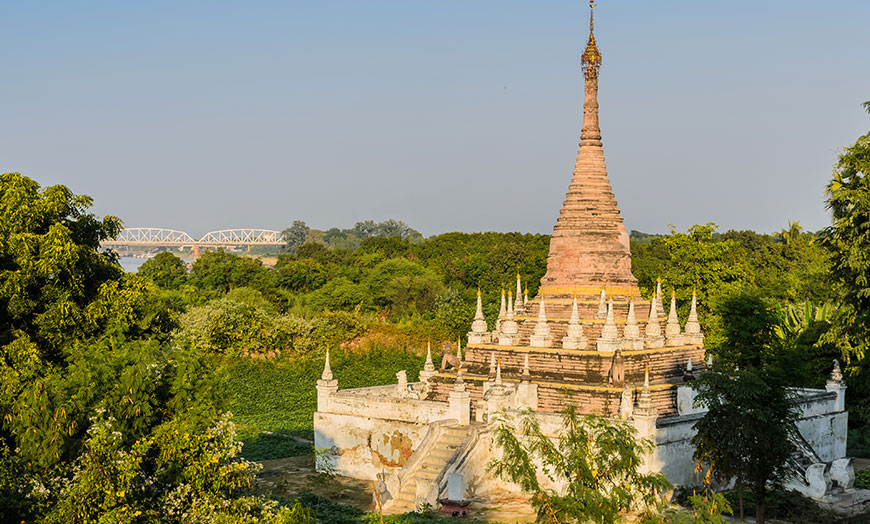 Stone stupa surrounded by trees in Burma