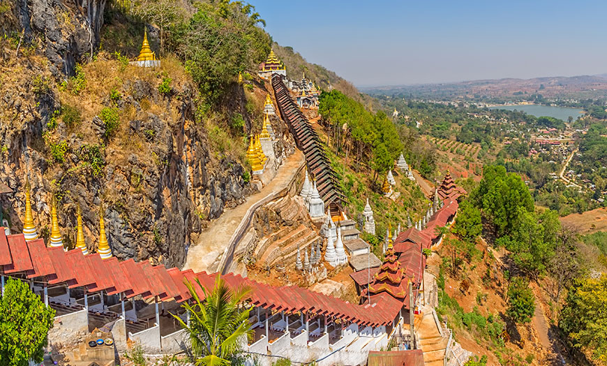 Temples clinging to a hillside in Burma