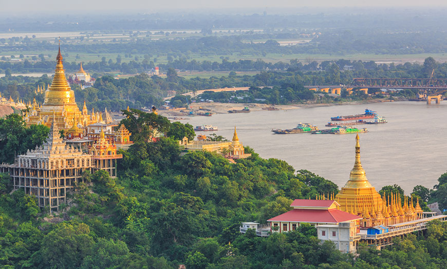 Golden pagodas overlooking a river in Burma
