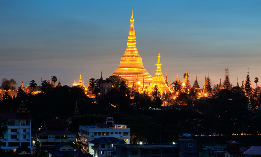Golden Burmese pagoda at night