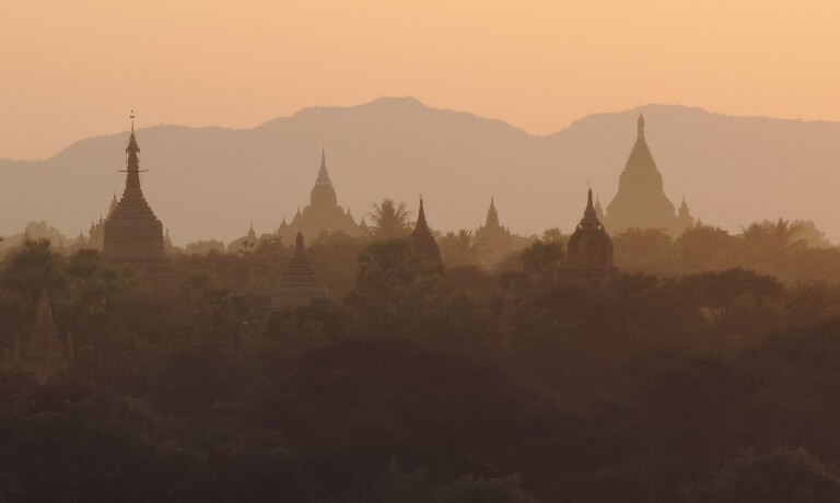 Silhouettes of temples at dusk
