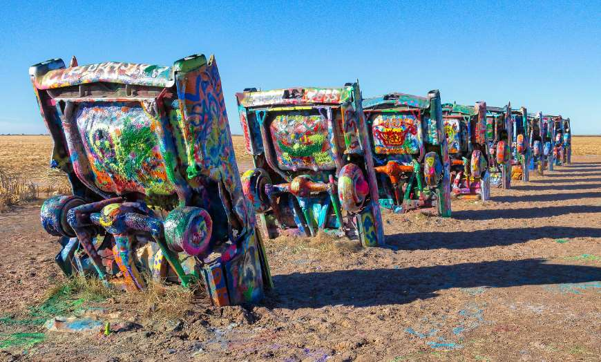 Upturned cars covered in graffiti at the Cadillac Ranch in the USA
