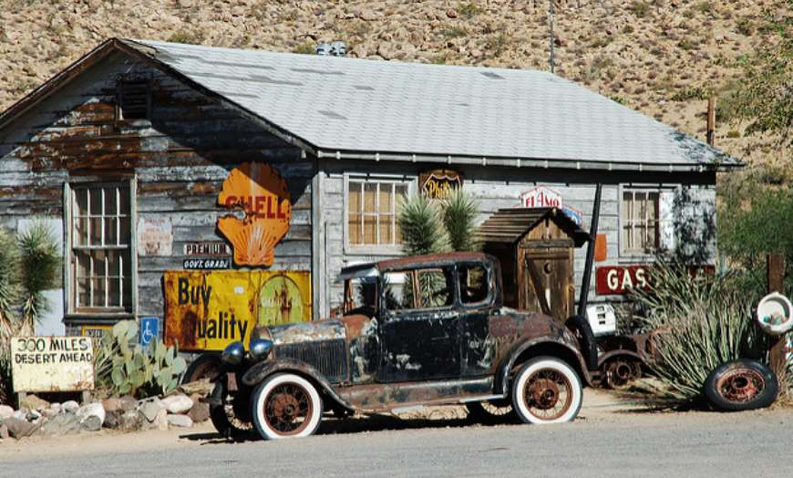 Old wooden home and historic car in Seligman, Arizona