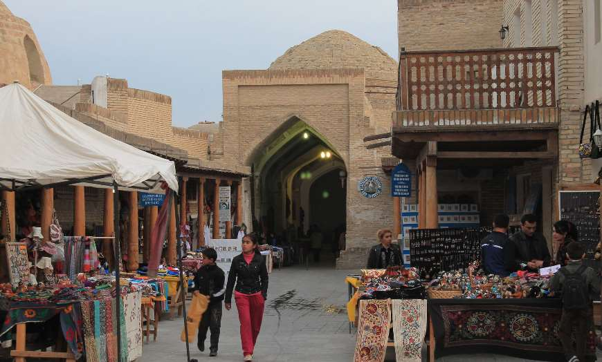 View of people shopping in one of the historic trading domes of Bukhara, Uzbekistan