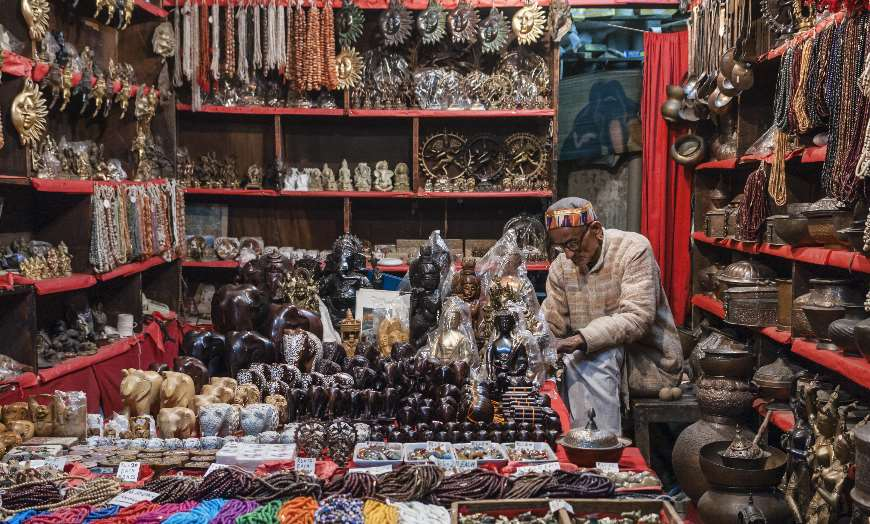 Old man sitting in his shop in India
