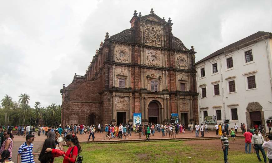 Historic and towering stone frontage of the Basilica of Bom Jesus in Old Goa