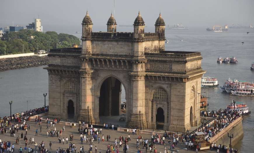 Aerial view of people walking around the Gateway of India in Mumbai