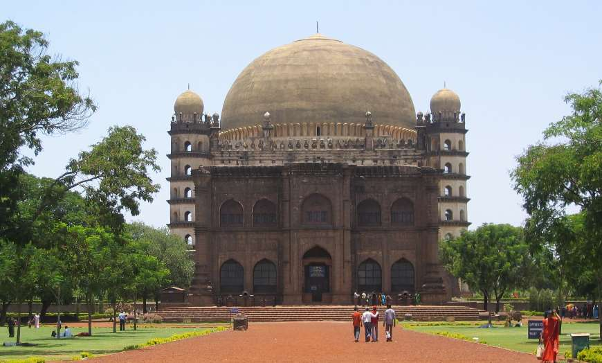 Huge dome and brick frontage of the Gol Gumbaz in Bijapur