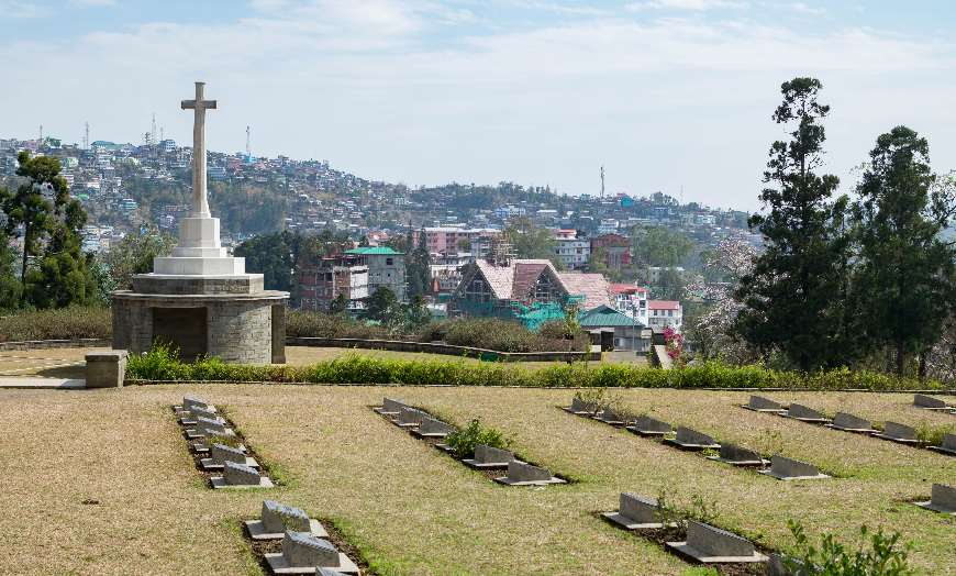 View of the Kohima War Cemetery with the town of Nagaland in the background