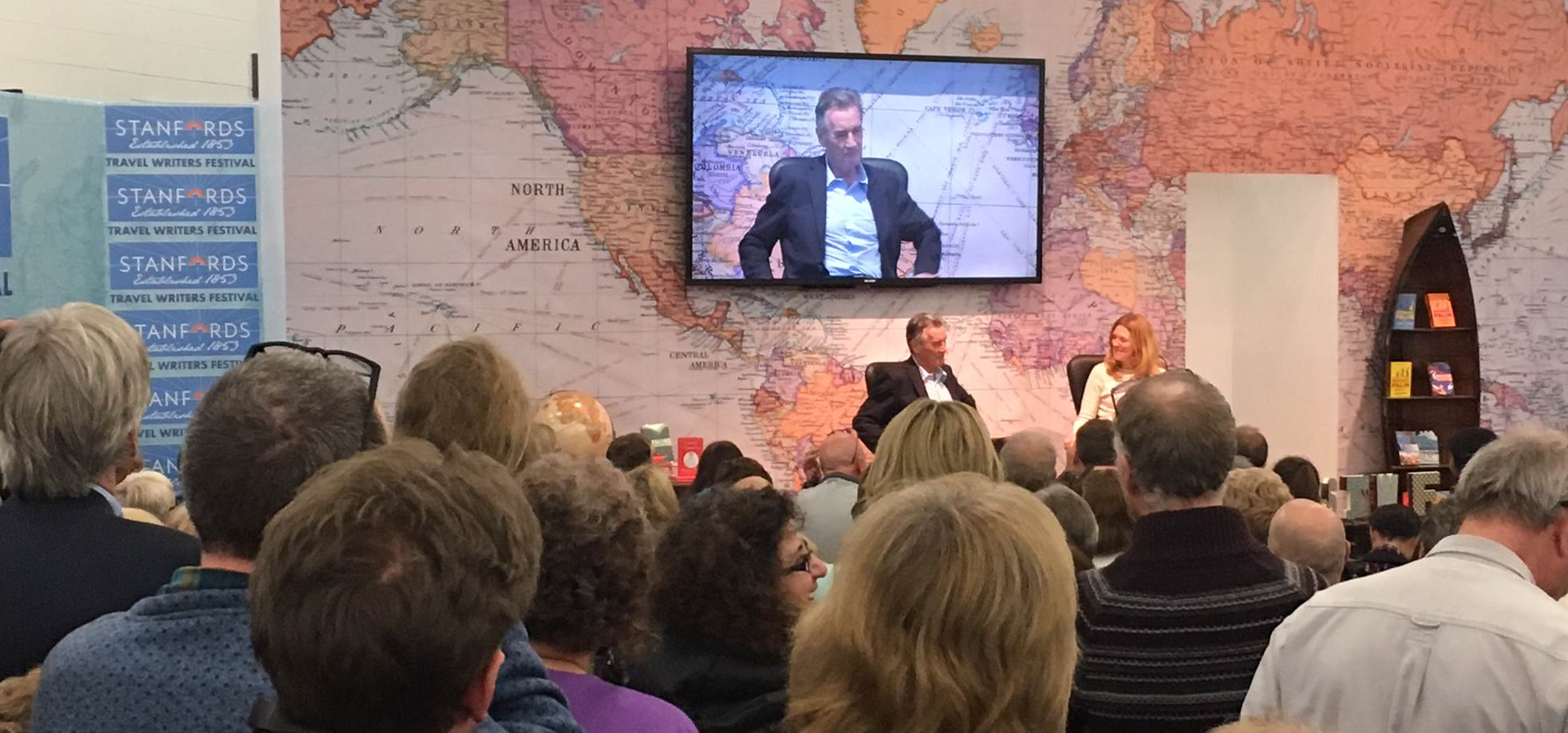 People attending a talk with Michael Palin at the Destinations Travel Show in London