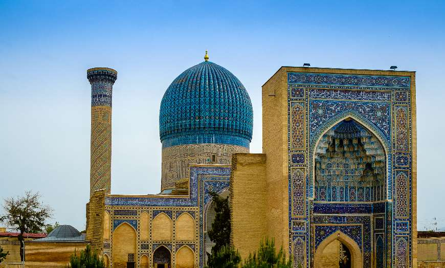 Blue-domed and tiled facade of a mausoleum in Samarkand, Uzbekistan