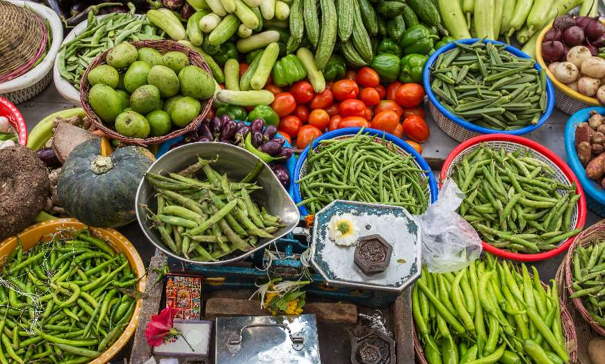 Market stall laden with vegetables and produce in India
