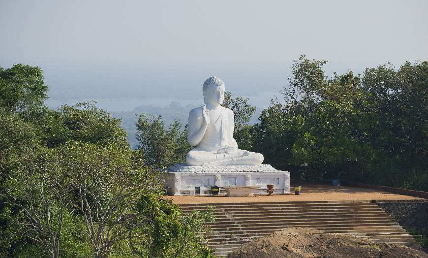 Monumental white seated Buddha at Mihintale, Sri Lanka