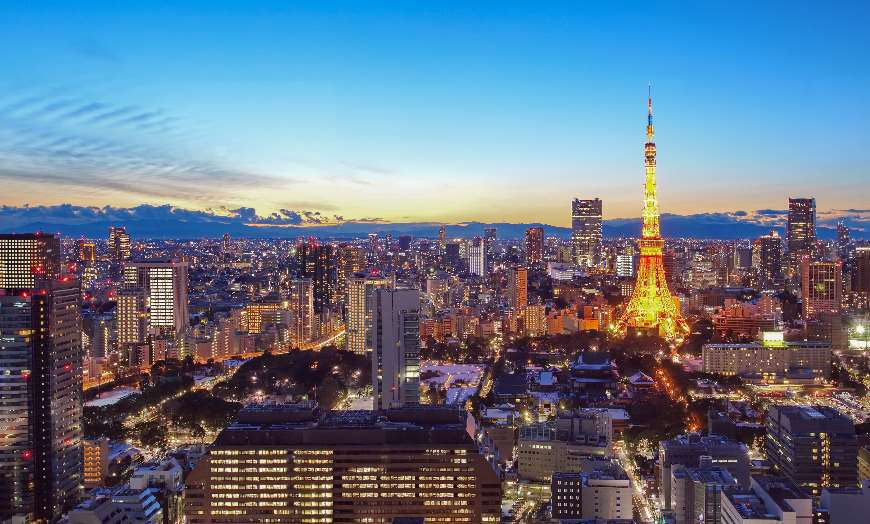 Panoramic view of Tokyo's modern cityscape at dusk