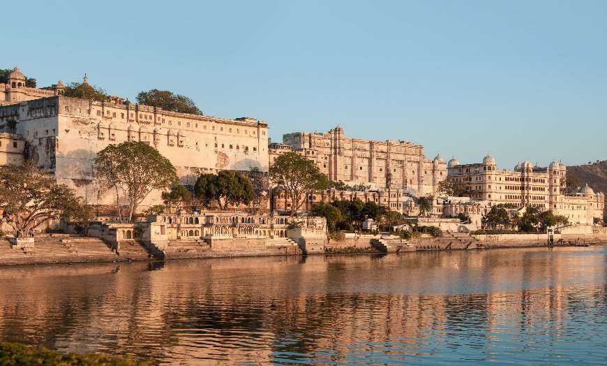 Grand City Palace complex overlooking a lake in Udaipur, India