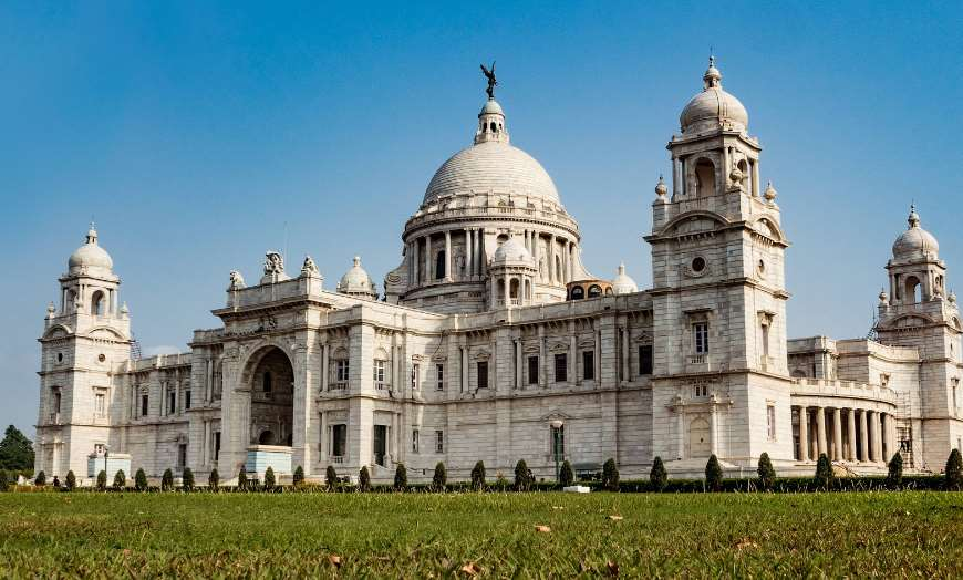 Grand domed marble facade of the Victoria Memorial in Kolkata