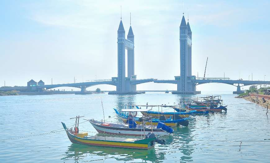 Modern architecture and traditional fishing boats in Kuala Terengganu, Malaysia