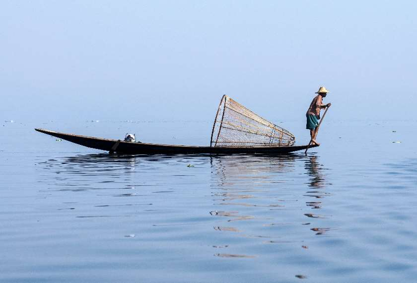 Fisherman rowing on Inle Lake in Burma