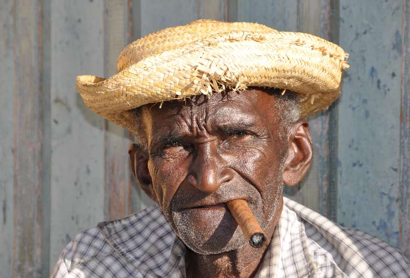 Cuban old man smoking a cigar