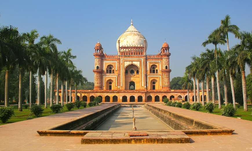 Tomb of Safdarjung in Delhi surrounded by palm trees