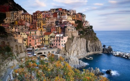 Colourful homes clinging to a rock-face, Cinque Terre, Italy