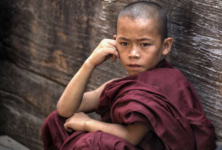 Novice Monk in red robes in Mandalay, Burma