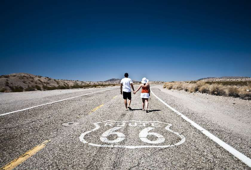 Couple walking down Route 66