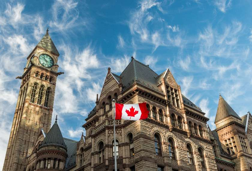 Canadian flag flies before Old City Hall Toronto Canada