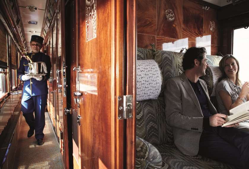 Waiter and guests on the Venice Simplon Orient Express