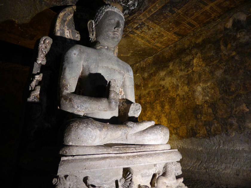 Seated stone Buddha statue in the Ajanta Caves, India