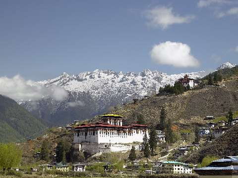 White-walled Paro Dzong in a valley with mountain backdrop