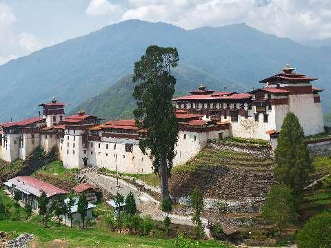 White-walled Trongsa Dzong stretched along a mountain ledge in Bhutuan