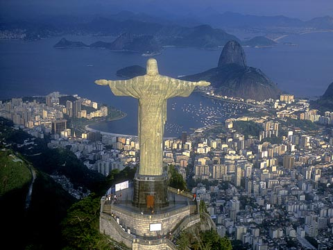 Aerial view from behind Christ the Redeemer statue with Rio de Janeiro in the background