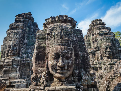 Monumental carved faces at the Bayon Temple in Cambodia