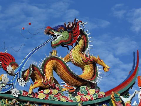 Close up view of a stylised multi-coloured dragon at a Chinese temple in Malaysia
