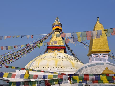 White domes and prayer flags of Bodhnath Stupa in Kathmandu