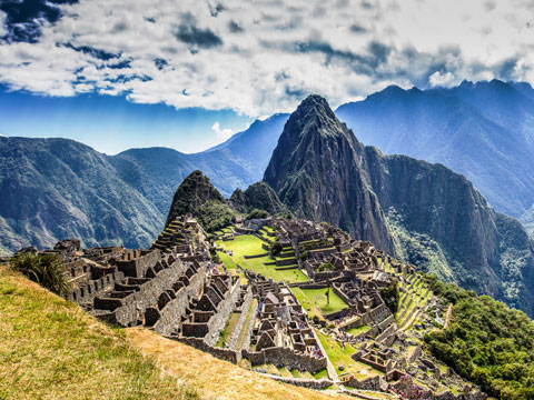 High mountain peaks surrounding the extensive remains at Machu Picchu