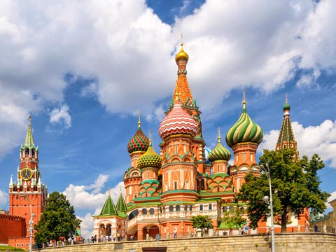 View looking up at the multi-coloured onion-shaped domes of St Basil's Cathedral in Moscow