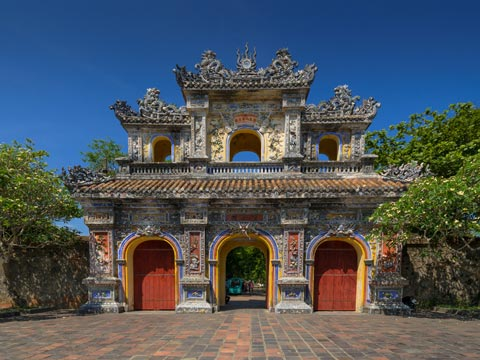 Traditional architecture of a highly decorated gateway at Dai Hoi Citadel in Hue