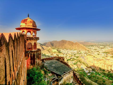 Wall and bastion of Amber Fort with views over the Rajasthani countryside