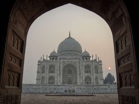Side view of the Taj Mahal in Agra at sunrise