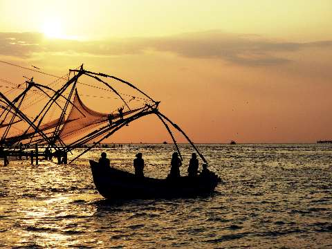 Chinese fishing nets in Kochi, India at sunset